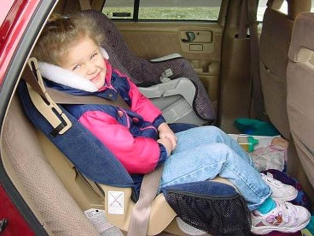 A child in a car seat.
