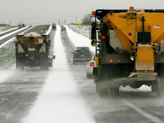 Snow plows clearing Michigan highways.