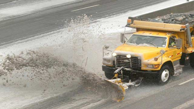 Plow clearing snow