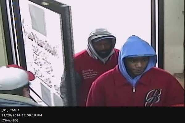 Surveillance photo of men in question.