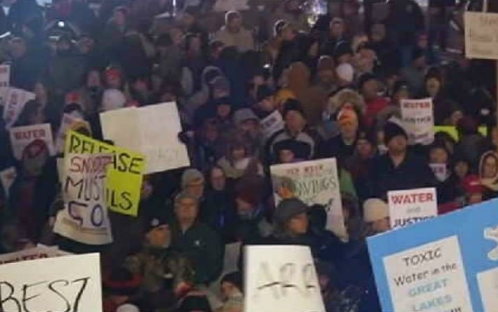 Hundreds of people took to the steps of Michigan's Capitol on Jan. 19 to express disgust in the state's handling of the Flint water crisis. Credit: WNEM