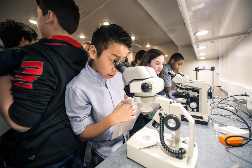 Students from White Pine Middle School in Saginaw Township explore the lab's scientific instruments.