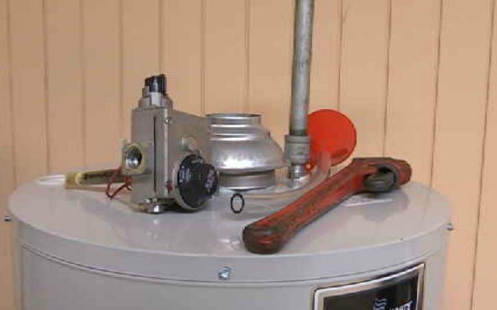 Local plumber demonstrates pipe maintenance