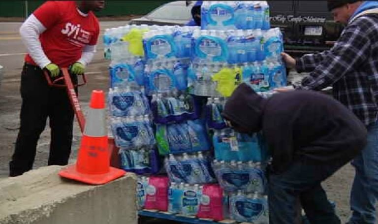 Members of the Toledo School District trucked more than 25 pallets of water to Flint. (Courtesy: WNEM)