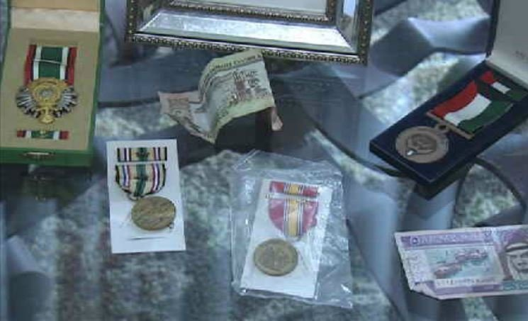 Stephanie Shannon displays some of her medals from her service in Iraq. Credit: WNEM.com