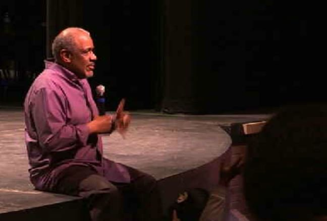 Flint-native and author, Christopher Paul Curtis speaks to a group of students. Credit: WNEM