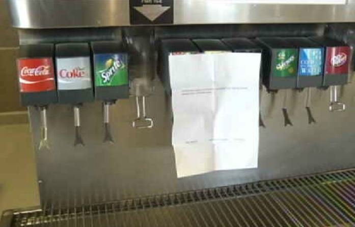 A sign warns customers about limited soda selection due to water boil advisory. (WNEM)