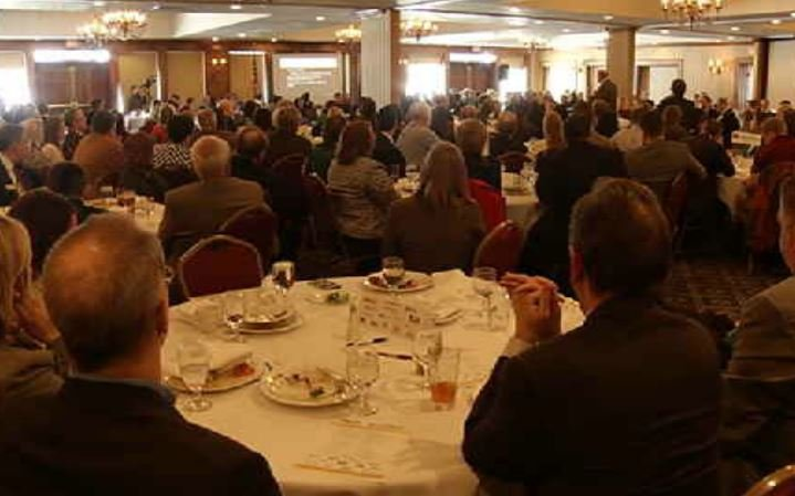 Business and political leaders listen to speakers during the State of the Community luncheon. WNEM
