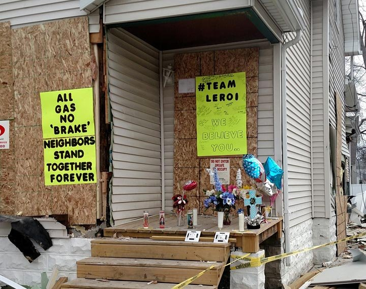 Neighbors build a memorial to Leroi Kocsis, the man who shot a police officer after police attempted to serve a warrant in relation to a criminal sexual conduct case Kocsis was fighting. (Faith Gantner, WNEM)