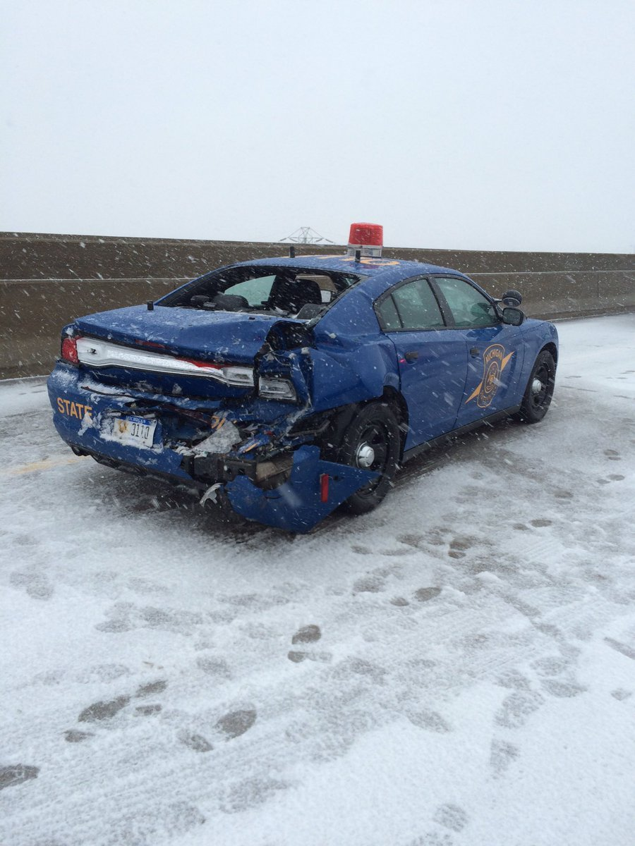 Trooper's vehicle hit while policing a crash. (Source: MSP)